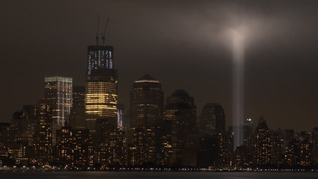 The 911 memorial lights light up the downtown skyline