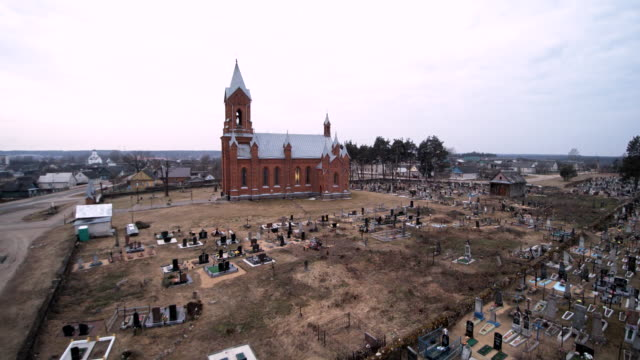 The aerial drone view of the Catholic cathedral of the Saint Aliaksey, XIX-XX centuries, in the Ivyanets city, Belarus, Eastern Europe.