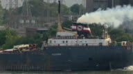 Detroit, Michigan - July 7, 2011: The Algoway, a self unloading bulk carrier ship, sails on the Detroit River.