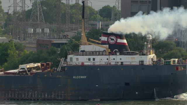 Detroit, Michigan - July 7, 2011: The Algoway, a self unloading bulk carrier ship, sails on the Detroit River.