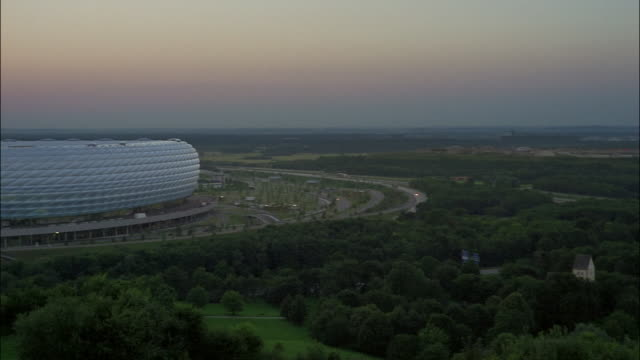 The Allianz Arena soccer stadium towers over the countryside in Munich.