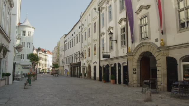 WS the Altstadt (Old Town) street, a narrow cobbled street running through the historic center of Linz