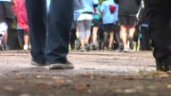 The Annual Sea Blue Prostate Cancer run in chicago raised more than $10000 to provide free services to prostate cancer survivors Tight Shot Of Feet...