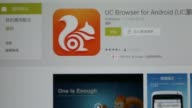 The application download page for UCWeb Inc s UC Browser is displayed on an Apple Inc iPad UCWeb Inc s UC Browser application loading page left and...