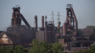 The ArcelorMittal steel mill complex stands in Cleveland Ohio US on Friday June 24 2016 Shots wide shot of steel mill as chemicals release into the...