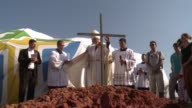 The Archbishop of Rio de Janeiro Joao Tempesta Orani blesses a vast site on which will be celebrated the closing Mass of Catholic World Youth Day...