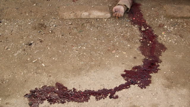 The arm of an Islamic State fighter and trail of blood in shot after he has been killed in battle