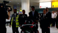 Alastair Cook and James Anderson return home London Heathrow Airport INT Alastair Cook in arrivals hall at Heathrow surrounded by photographers Cook...