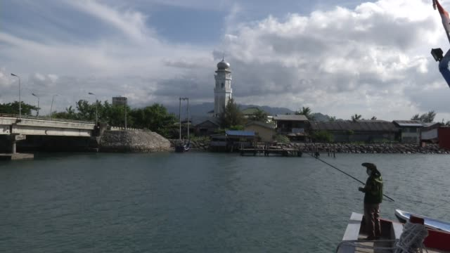 The Baiturrahm Mosque calls to prayer near the waterfront area in Ulee Lheue Aceh Indonesia
