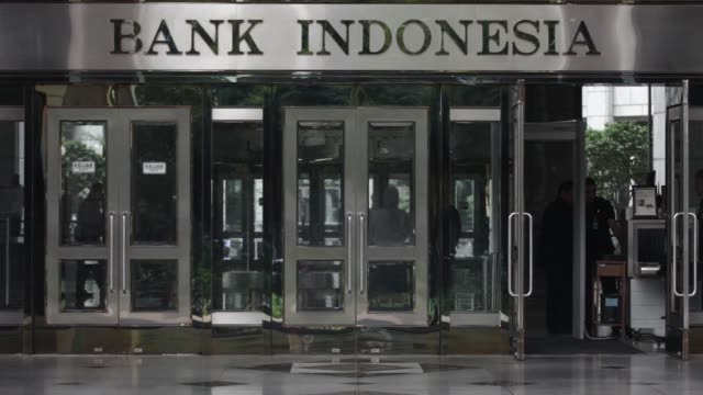 The Bank Indonesia headquarters stand in Jakarta Indonesia on Thursday Nov 16 A customer exits the Bank Indonesia headquarters building Customers...