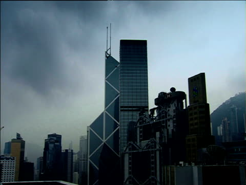 The Bank of China HSBC and Standard Chartered headquarters with threatening clouds above Hong Kong.