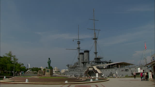 The battleship Mikasa is moored on the waterfront at Yokosuka.