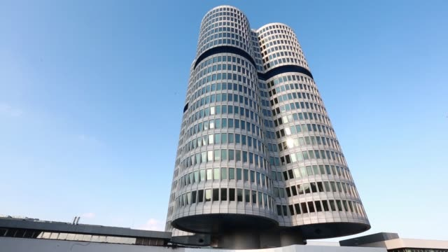 The Bayerische Motoren Werke AG headquarters stands beside the BMW museum in Munich Germany on Friday February 27 2015