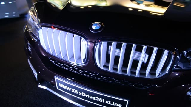 The Bayerische Motoren Werke AG logo is displayed at booth A BMW 6401 Gran Coupe on display at booth A BMW 35i on display Close up of BMW logo on...