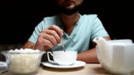 the bearded young man prevents the tea in a cafe