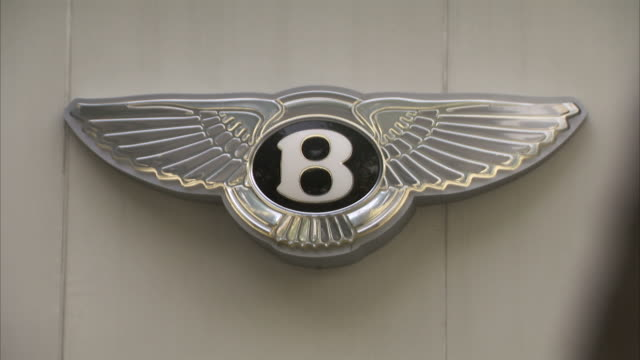The Bentley auto log decorates a car dealership in Delhi, India.