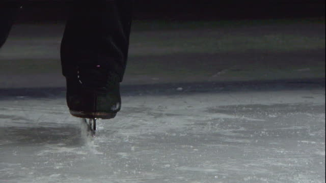 The blade of a figure skater toe picks, jumps and spins off the ice.