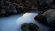 The Blue Lagoon flows around a lava field in Reykjavik, Iceland. Available in HD