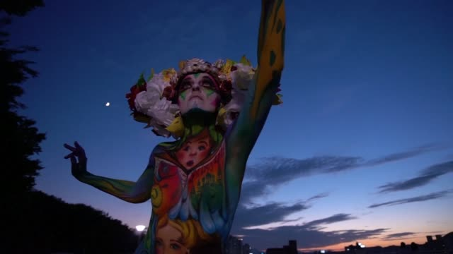 The bodies of dozens of female models are turned into living canvases at a festival in South Korea as delicate brush strokes and flamboyant...