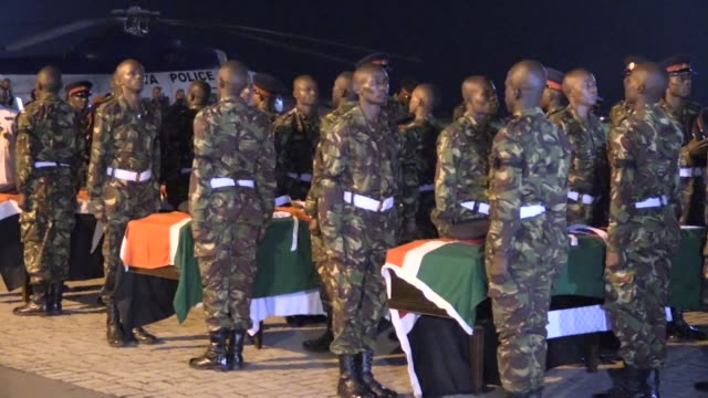 The bodies of four Kenyan defense forces killed in Somalia during an attack on an AMISOM base were flown to Nairobi on Monday