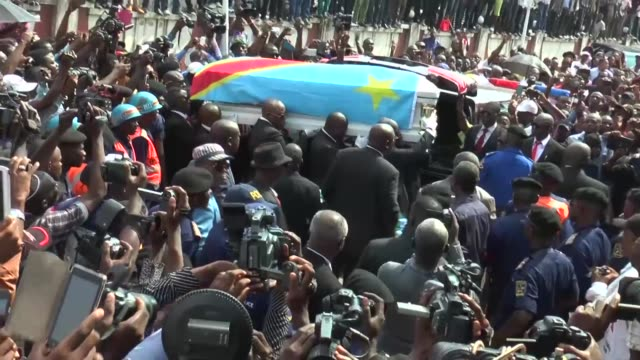 The body of Congolese rumba king Papa Wemba arrived home in Kinshasa on Thursday greeted by dignitaries relatives and a huge crowd of distraught fans