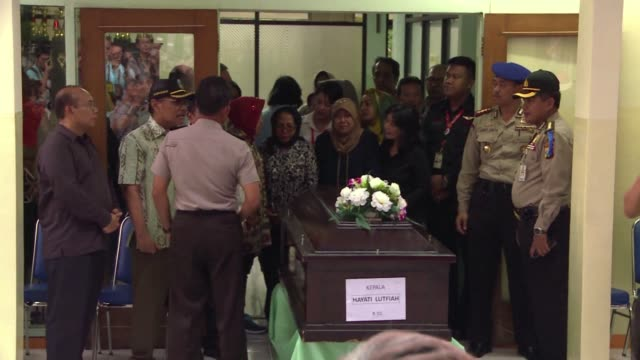 The body of one of the victims in the AirAsia crash is returned to the family