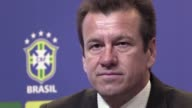 The Brazilian Football Confederation fires coach Dunga after the national teams early exit from the Copa America Centenario