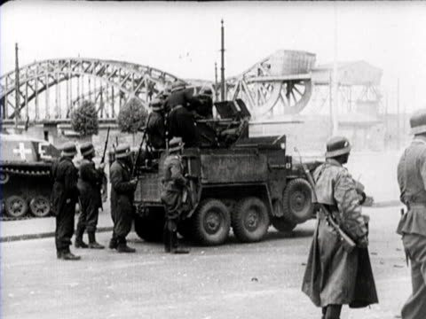 The bridge over the river Duena is destroyed by the Russians The German troops cross the river by boat