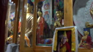 The Buddha Statue and the interior of the main prayer room of the Samstanling Monastery, Nubra Valley, Ladakh, India