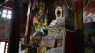 The Buddha Statue inside the main prayer room of the Samstanling Monastery, Nubra Valley, Ladakh, India