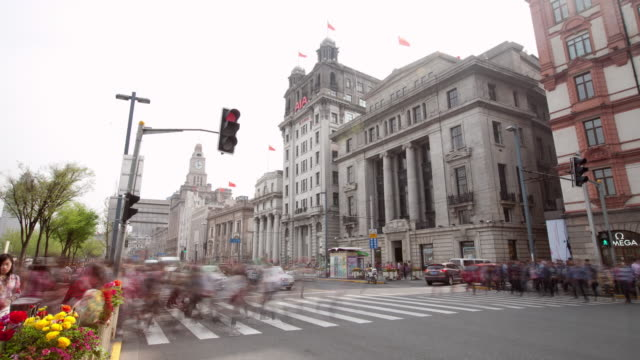 The Bund in Shanghai,modern buildings exterior and walking pedestrians,Time lapse