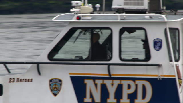 The cab of a NYPD patrol boat as it heads up river.