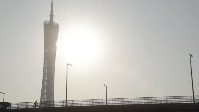 The Canton tower stands in the background as traffic drive past on the Liede Bridge over the Pearl River in Guangzhou China on Tuesday Oct 31...