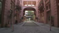 The Casa de Cultura Mario Quintana forms a narrow alleyway in Porto Alegre, Brazil.