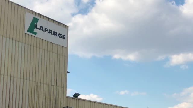 The cement manufacturer Lafarge in Paris on the banks of the Seine river Lafarge Holcim is a company delivering cement concrete and aggregates...