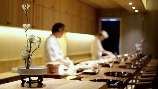 The chef makes sushi in the restaurant on May 11 2017 in Shanghai China