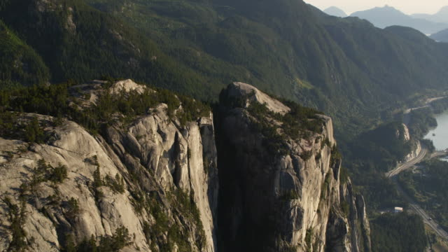 AERIAL 'The Chief' rock face and Howe Sound at Stawamus Chief Provincial Park / British Columbia, Canada