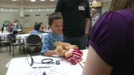 The Children's Medical Center held a teddy bear clinic to help children understand what goes on in a hospital on March 13 2014 in Dallas Texas...