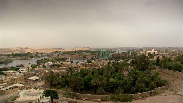 The city of Aswan sits along the River Nile.\n Available in HD.
