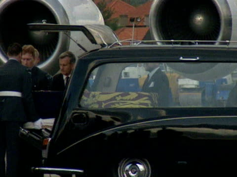 The coffin containing the body of Princess Diana draped in the Royal Standard is placed into a hearse at RAF Northolt 31 August 1997