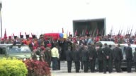 The coffin of Venezuelan President Hugo Chavez whose body has been on public display since he died on March 5th was carried through Caracas on Friday...