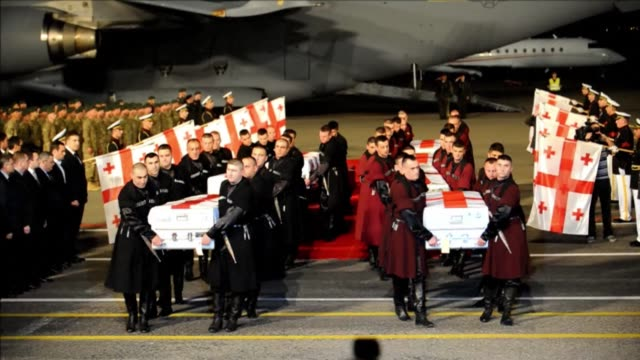 The coffins of seven Georgian soldiers killed in a suicide attack in Afghanistan arrived in Tbilisi Sunday CLEAN Coffins of Georgian soldiers killed...