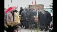 The coffins of three of Nelson Mandelas children are brought to a burial site at the former South African presidents compound in Qunu CLEAN Coffins...