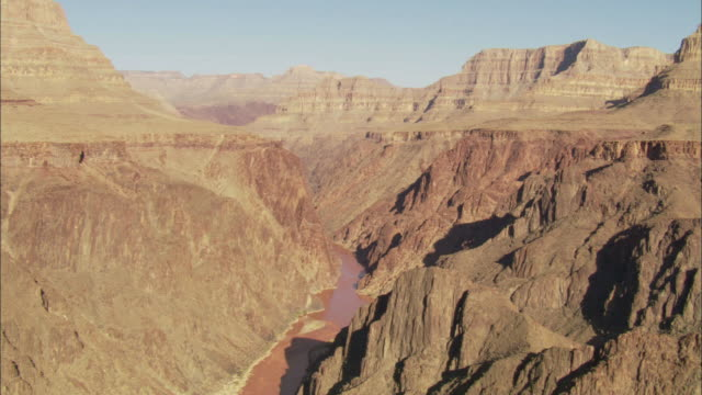 The Colorado River winds through the Grand Canyon.