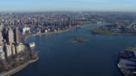 The confluence of the East River and the Harlem River in New York City, seen from an aerial perspective.