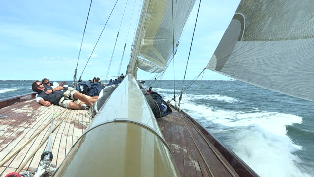 The crew of the J Class yacht Velsheda keep low to the deck while racing in the J Class Regatta.