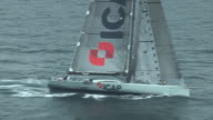The crew on the racing yacht, ICAP Leopard, change a headsail during a race across the Atlantic Ocean.