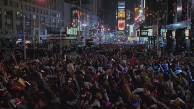 The crowd cheers in Times Square on New Year's Eve.