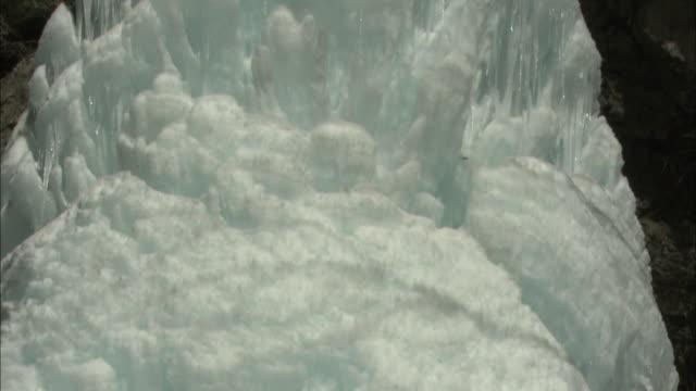The Daizen Waterfall forms an ice pillar in Kitaaiki, Nagano.