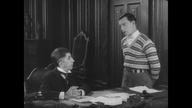 The dean has a talk with Buster Keaton about his poor study habits